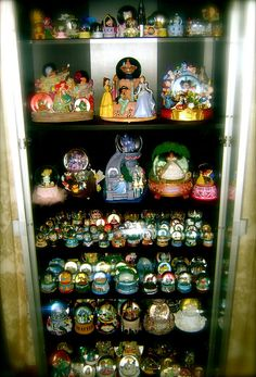 An awesome collection of snowglobes - this looks like something I would do....
