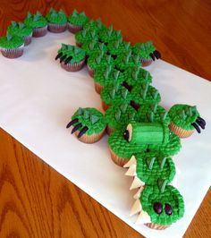 Cupcake Croc - As seen in Hello Cupcake book.  My kids school mascot is a crocodile!  Eyes and teeth used marshmallows.  Scales used green Wilton candy melts cut into triangles.  Black mmf claws and nostrils.