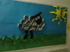 paper-quilled sheep and sun bulletin board display