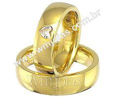 Alianças de casamento coração Aliança de noivado e casamento Aliança em ouro amarelo 18k 750 Peso: 16. gramas o par Pedras: 1 diamante Coração 3x3 largura: 6mm Altura: 1mm Anatômico baixo Acabamento liso