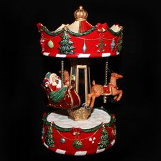 Wind-up this musical carousel to see Santa and his reindeer revlove around and around.  Colour: Red/Green Product type: ChristmasCollectable Size:  Made of:Resin Code: PM4011