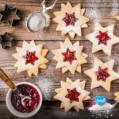 Christmas Linzer cookies with raspberry jam by nblxer. Christmas Linzer cookies with raspberry jam on a rustic wooden background Christmas Candy, Christmas Baking, Christmas Time, Star Cookies, Holiday Cookies, Cookie Recipes, Dessert Recipes, Desserts, Galletas Cookies