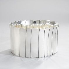 By Owe Johansson. sterling silver, Varberg in 2003, round, straight edges constructed of rectangular tiles, irregular opening edge.