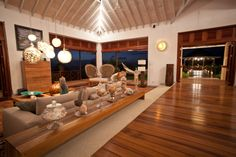 A stunning villa in the caribbean by Nomade Architettura http://www.nomadearchitettura.com/#all  teak floor, local briks, hanging metal lighting by zenza lighting