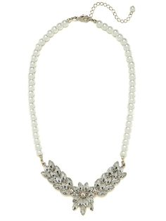 This striking necklace marries a supremely romantic vibe with a superb luxe factor. It's all in that mix of pretty pearls and floral marquise gems.
