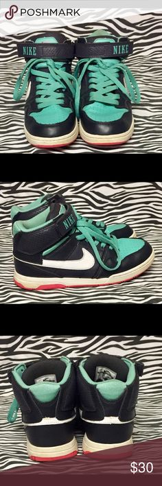 Girls Turquoise/Black/White/Pink Nike 6Y Hi Tops. Turquoise/Black/White/Pink Hi Tops with Turquoise laces and a Ankle strap. Little signs of wear on shoes and bottoms both in good condition. Nike Shoes Sneakers