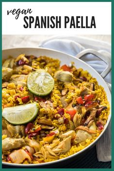 Paella The most flavorful vegan paella you'll ever taste! Spanish rice simmered in vegetable stock, wine, and belly-warming Spanish spices!The most flavorful vegan paella you'll ever taste! Spanish rice simmered in vegetable stock, wine, and belly-warming Vegetarian Paella, Easy Vegetarian Dinner, Vegan Dinner Recipes, Vegan Dinners, Vegan Vegetarian, Vegetarian Recipes, Healthy Recipes, Healthy Food, Cheap Recipes