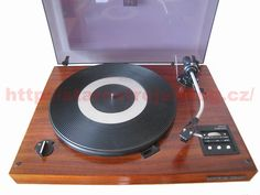 """Class chassis stereo Hi-Fi in a wooden base with a hinged lid. Speed 33 1 / 3 and 45 rpm, belt drive plate, trailing off photoelectric system, automatic lift arm end plate and press the STOP button. Antiskating, using low-lift control buttons. Arm P1101 - copies of SME companies. Weight plates / grama overall 2,5 / 10 kg. Phonographs were made from 80th-88th Year. This turntable is one of the """"best of"""" gramophones manufactured by Tesla Litovel with NC 440."""