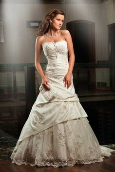 A body hugging bodice with a flared lower half wedding dress from Annais Bridal