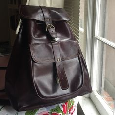 Leather backpack Brown leather backpack. One zip pocket against the back. Ties at top and closes with a latch button. Front pocket is missing the latch. Great vintage condition, which means there will be skme minor scratches. Adjustable straps. Bags