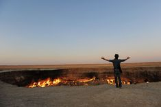 The challenge: peer over the edge of the real-life, ever-burning crater known as the Gates of Hell Most travel ads promise you Heaven on Earth, but it turns out that tours to Hell are available, too.   #Asia #203Challenges #Gates of Hell #Turkmenistan #unusual places