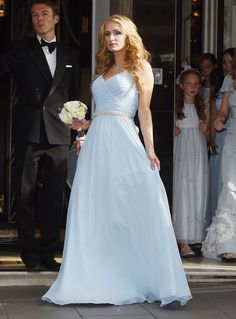 Paris Hilton attends her sister's wedding in a pale blue gown with a crystal belt