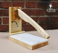 This lets you stamp without a hammer. Had to look at it twice to figure it out, but now I want one! http://elfitakorea.blogspot.ae/2013/08/hand-press.html