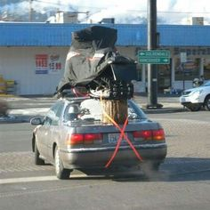 One way to haul a snowmobile.