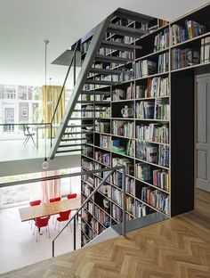 Load-bearing wall converted into a bookshelf  Vertical Loft by Shift