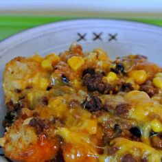 Tater Tot Taco Bake.  1 # hamb, 1 tsp minced garlic, 1 pkg taco seasoning, 1 drained can of corn, 1 rinsed & drained can of black beans, 16 oz shredded Mexican cheese blend, 32 oz tator tots & 19 oz enchilada sauce.
