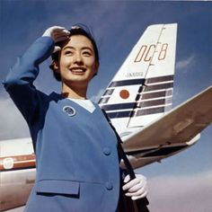 JAL Japan Air Lines Stewardess posing with a DC-8 tail