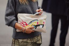 Vroom goes the Prada clutch as the fingers go flying.