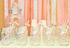 Adorable: mason jars and fun straws make the perfect party display!