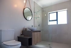 Clean and simple design open plan layout with functional spaces,natural wood textures add warmth. Designer home in Langebaan Country Estate. Country Style Bathrooms, Modern Country Style, Grey Interior Design, Bathroom Interior Design, Timber Vanity, Cupboard Ideas, Frameless Shower, Metal Mirror, Country Estate