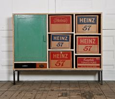 Salvaged furniture by east London's Rupert Blanchard (found on Spitalfields Life). Cardboard boxes as drawers = great idea.