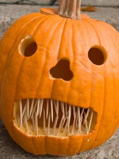 A simple, smiling jack-o'-lantern is a traditional element of Halloween decor. Check out these classic pumpkin carving ideas with a humorous twist.