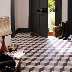 Geometric Floor tiles evoke Art Deco styling. Simple to recreate you could always follow this look through into your dining room and conservatory.