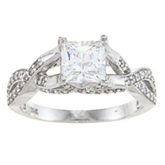Featuring a high-quality princess-cut cubic zirconia center stone, this unique ring is accented with round-cut cubic zirconia set down the shank. Crafted of 14-karat white gold, this stylish ring shin