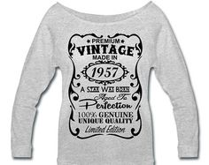 Birthday Design in white Velvety print on a Quality Women's Wide-neck Sweatshirt 60th Birthday Gifts -­ This is unique personalized birthday gift for anyone who is turning 60 this year.  The unique design says: Premium Vintage - Made in 1957 - A Star Was Born - Aged to Perfection -­ 100% Genuine - Unique Quality ­- Limited Edition.  ----  Product Quality: Womens Wide-neck Sweatshirt  An 80s twist on a classic style. Super soft and lightweight triblend sponge fleece sweatshirt with extended…