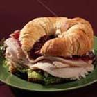 Turkey Cranberry Croissant - Not an ordinary turkey sandwich, this one adds a cream cheese spread with pecans and marmalade topped off with cranberry sauce.