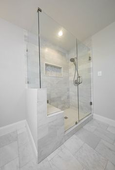 Love this extra large white marble master shower with built in seat and frameless glass | Pig + Tiger Renovation Dallas
