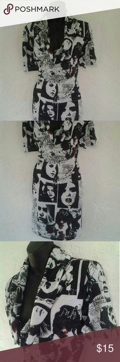 Lane Bryant sexy Tunic Top..With Faces 14/16 Lane Bryant tunic top with faces in excellent condition only worn once..100% polyester. Please feel free to ask any questions you may have..Thank You Happy Poshing Lane Bryant Tops Tunics