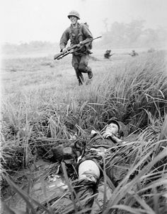 The Jungle War - October 1966 - The soldier was probably wounded during an ambush or a mortar attack.  Photo by Kyoichi Sawada
