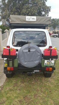 Suzuki Jimny water and petrol holder. (Storage)