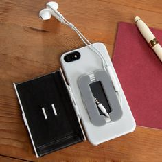 Folio iPhone case. Acts as a wallet on the outside and opens up to an earphone organizer. Kind of awesome for how slim it is!