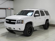 Chevrolet Tahoe white, lifted, fender flares, blacked out grill/emblems, white roof rack Lifted Chevy Tahoe, 2007 Chevrolet Tahoe, Chevrolet Silverado, New Trucks, Lifted Trucks, Chevy Trucks, Pickup Trucks, Custom Trucks, Chevy Models