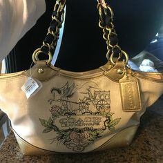 NWT COACH SHOULDER PURSE. Beautiful detail, zipper zips and detaches very unique so you never have to worry about tearing a zipper out. Feels like a burlap or Jean type material with metal and black shoulder straps. Great gift for any occasion. This also comes with the Cover pouch. Coach Bags Shoulder Bags