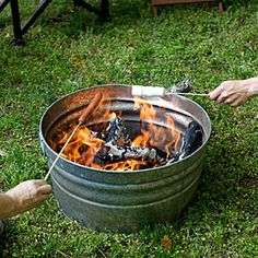 "Portable Fire Pit Idea/Backyard ""Campout"" Party/Beach Fire-Haul your wood in the container then instant fire. How about putting the galvanized tub inside the rock or rock wall. Backyard Camping, Fire Pit Backyard, Backyard Landscaping, Backyard Kids, Backyard Seating, Landscaping Ideas, Camping Fire Pit, Backyard Beach, Backyard Designs"