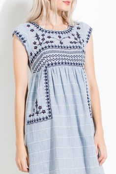 Love the feminine floral embroidery and empire waist on this boho inspired dress!