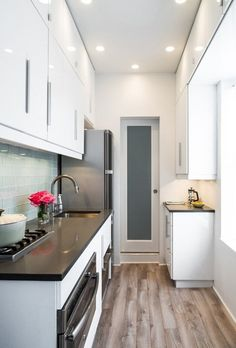 Jennifer's Small Space Kitchen Renovation: The Big Reveal — Renovation Diary. Small customizd white kitchen.
