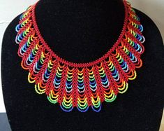 Rainbow Seed bead necklace Hundreds of beads used. Seed Bead Necklace, Seed Beads, Crochet Necklace, Orange And Turquoise, Turquoise Color, Aztec Necklaces, Low Cut Dresses, Beaded Christmas Ornaments, Beaded Collar