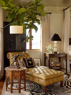 masterful mix of layers. The chinoiserie pieces (the nightstand and screen) complement a Syrian side table, a zebra rug and an antique English chaise. The success comes from the mixing of textures and the consistency of color, as well as the unique provenance of each piece.