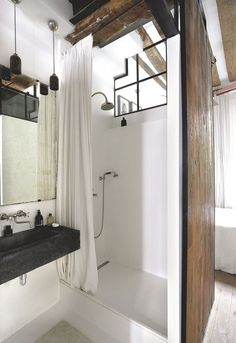 "The bathroom is protected by a sliding door flooring recycling craft home Palatino.  Stone basin of Hainaut, Volevacht taps, wall and floor polished concrete.  The structure of the openings is black metal.  Suspensions ""Gazy,"" Thank you."