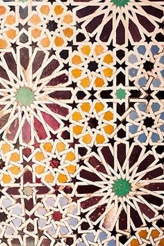This picture of a mosaic tile floor would make a interesting wall paper design.