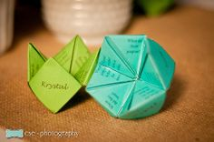 Cootie catchers with facts about the couple as part of the centerpiece #bride #wedding #reception #party
