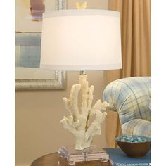 White coral table lamp on lucite base.