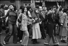 Anti-Shah demonstrators, marching near a shopping street in Tehran, Dec. 27, 1978.