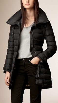 Burberry Black Down-Filled Puffer Coat - A down-filled coat with a protective funnel neck, throat latch and detachable packaway hood. Inspired by heritage outerwear, the coat features epaulettes, cuff tabs and a multistitch belted waist. Discover the women's outerwear collection at Burberry.com
