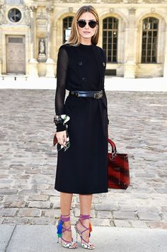 Olivia Palermo in a black ensemble with strappy heels with tassels