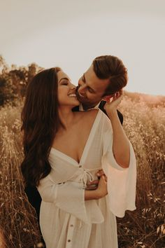 Engagement session outdoors in a field in Las Vegas with The Light and The Love Photography Couples session inspiration engagement session posing ideas engagement session outfit ideas engagementphotography -